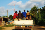A Road of Progress: An Urban Dala-dala Carries Boys through Town
