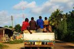 A Road of Progress: An Urban Dala-dala Carries Boys through Town