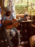 Mama playing the Ukulele by Sarah Brink
